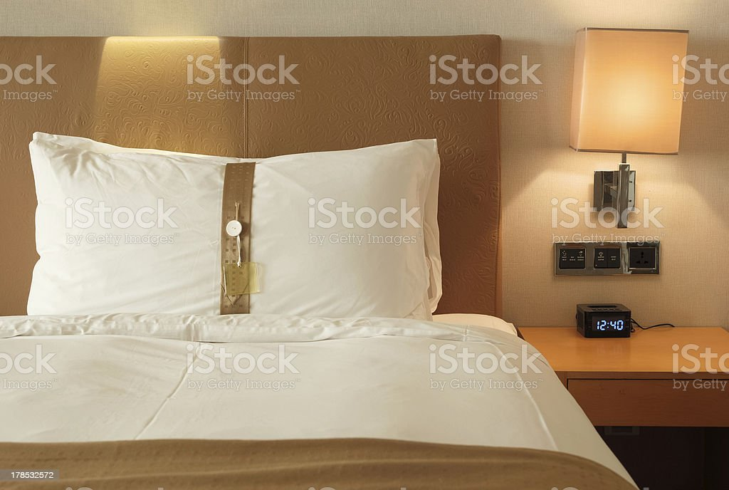bed in a hotel room royalty-free stock photo