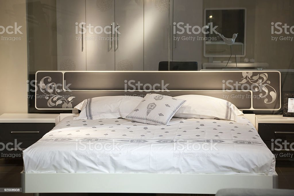 Bed in a luxury  room royalty-free stock photo