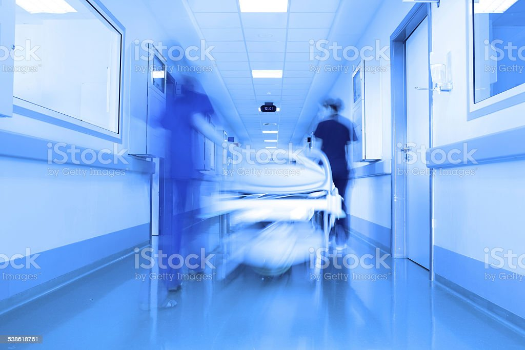 Bed in a modern clinic corridor stock photo