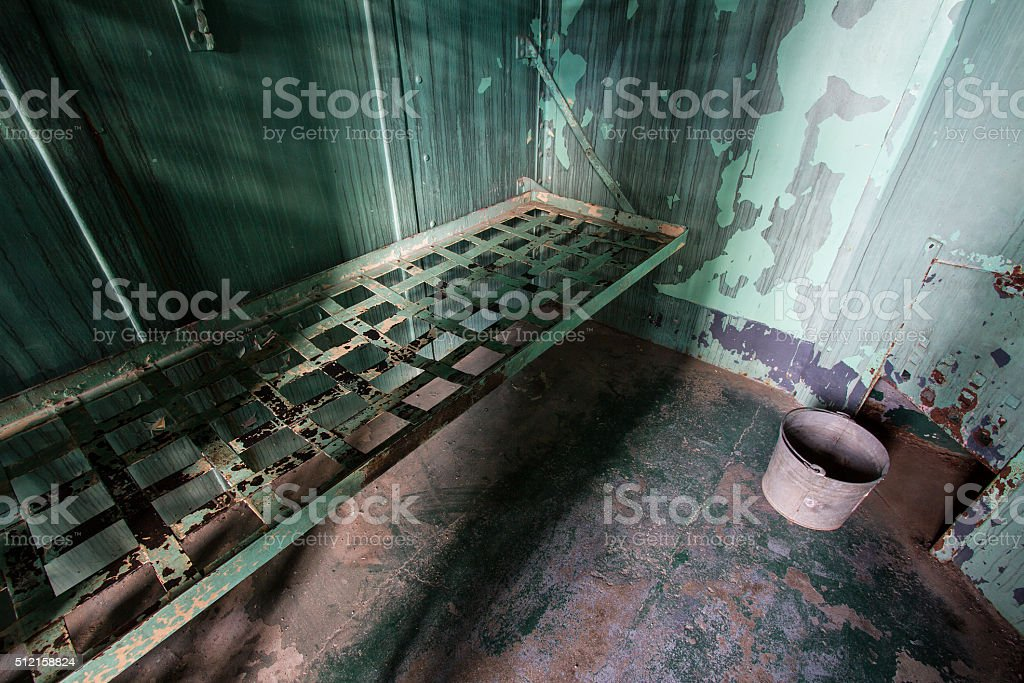 bed in a prison stock photo