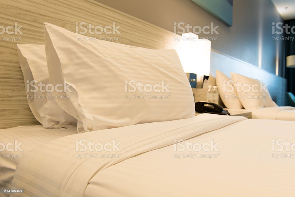 Bed in hotel room stock photo