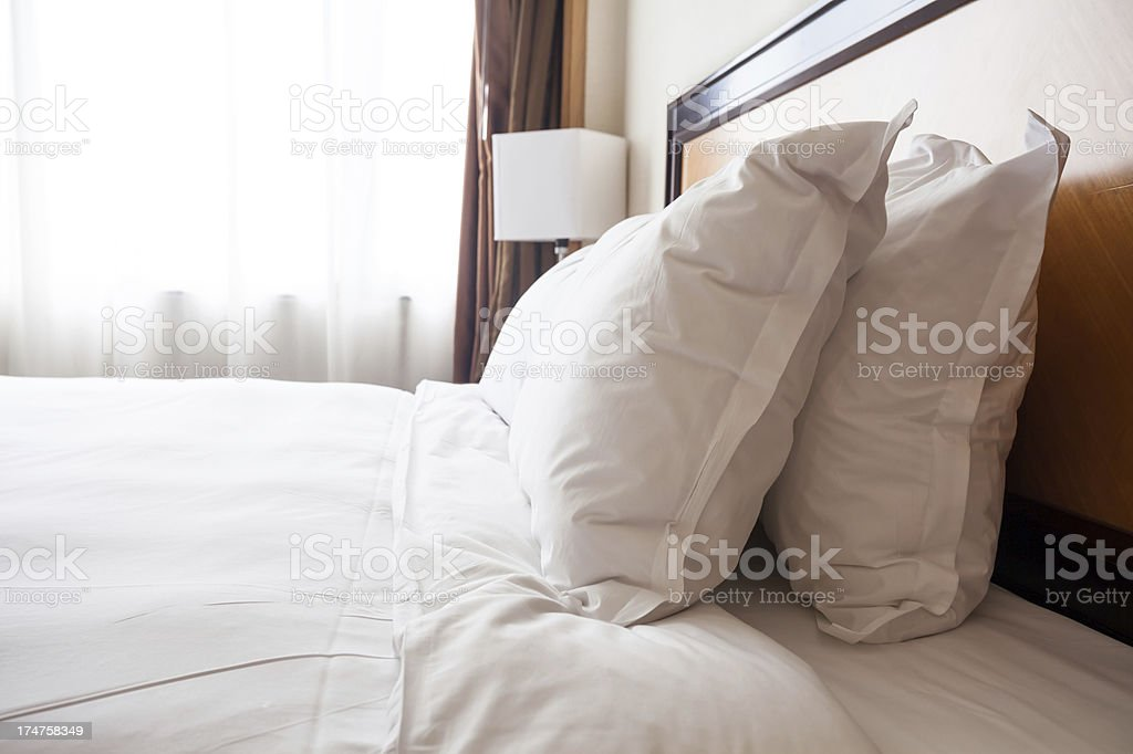 bed in living room royalty-free stock photo