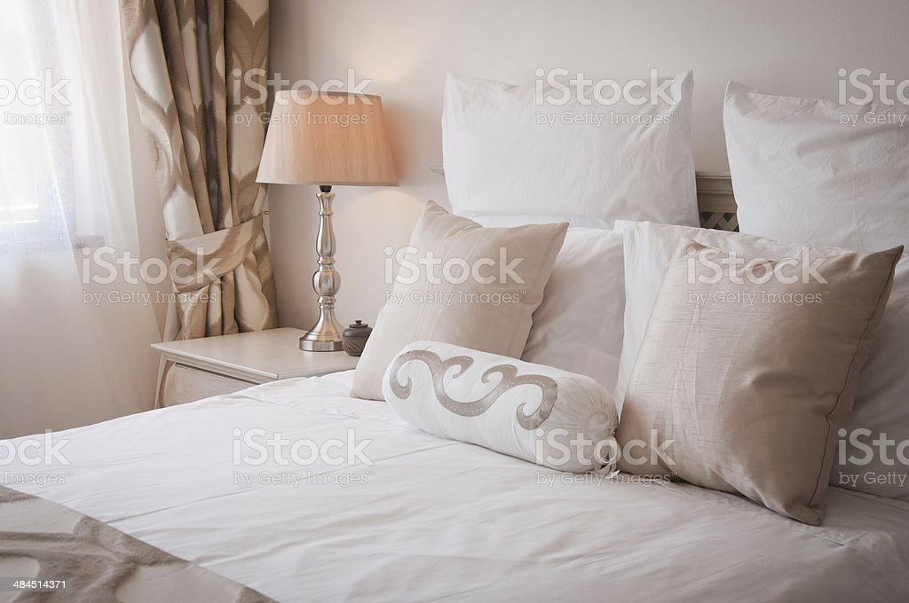 Bed in room stock photo