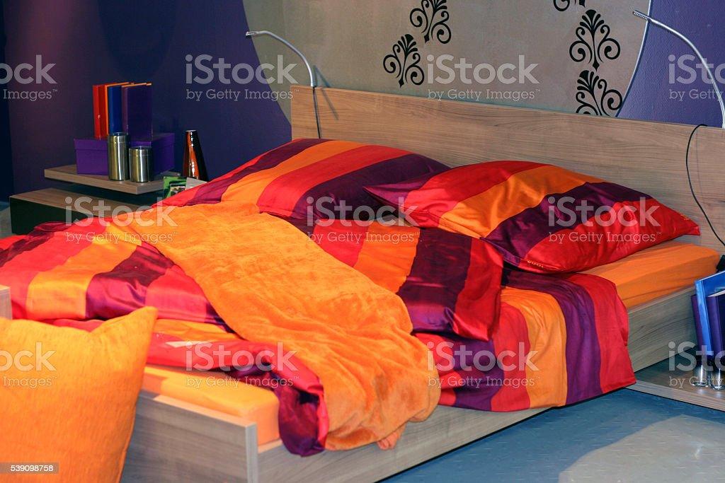 Bed in sleeping room stock photo