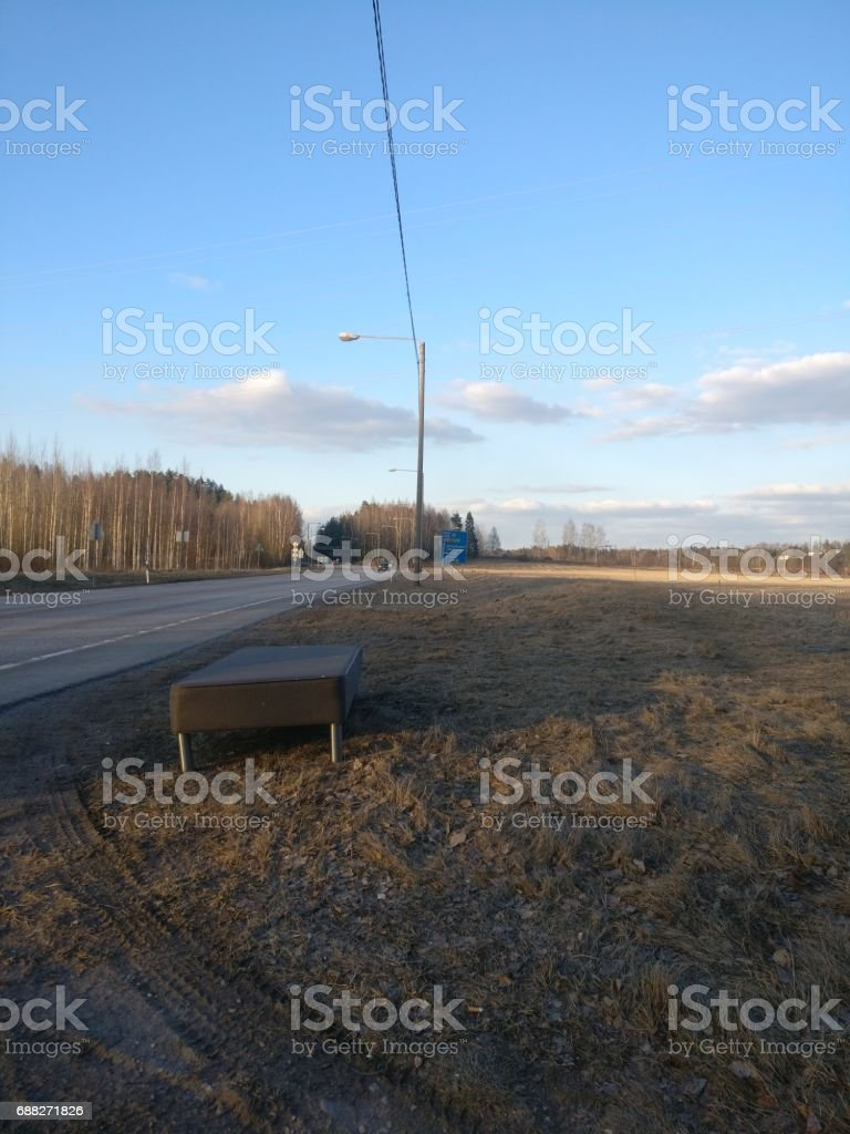 A bed left near a highway stock photo
