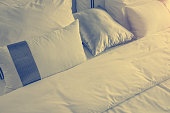 Bed maid-up with clean white pillows and bed sheets