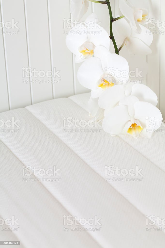 Bed Mattress with Orchid stock photo