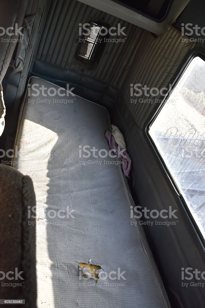 bed of a truck driver stock photo
