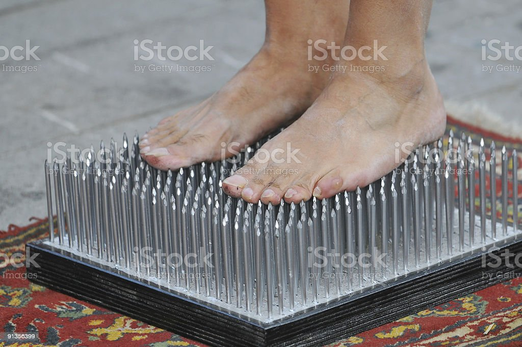 Bed of nails stock photo
