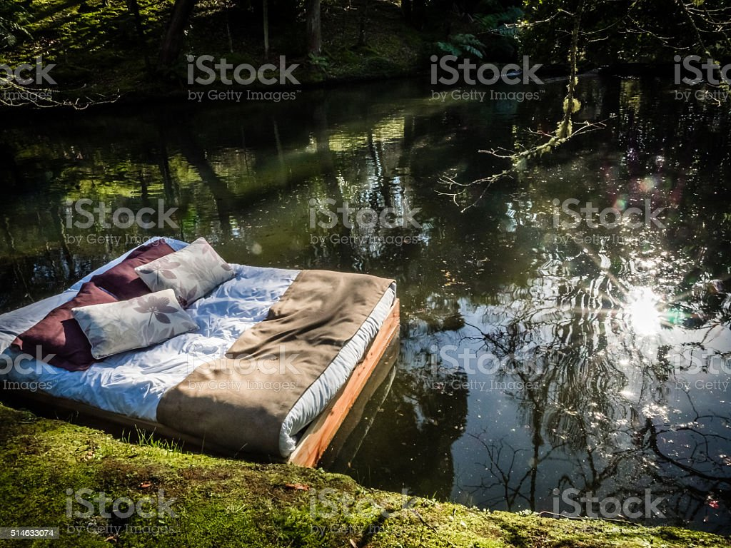 Bed on a lake stock photo