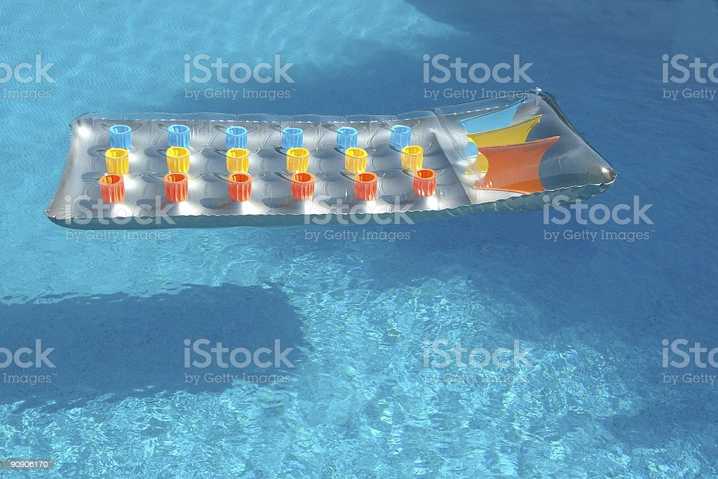 Bed raft in the swimming pool royalty-free stock photo