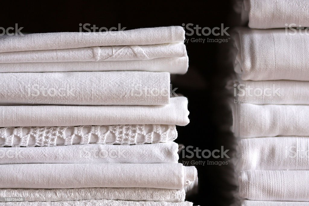 Bed sheet pile and dark background royalty-free stock photo
