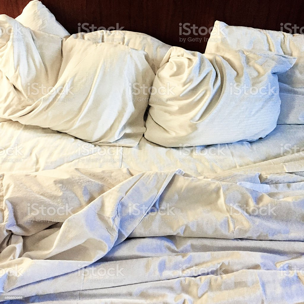 Bed Sheets and Pillows Rumpled and Texture Added stock photo