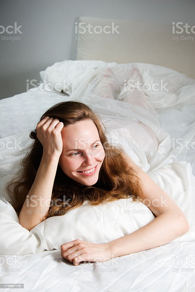 Bed smiling royalty-free stock photo