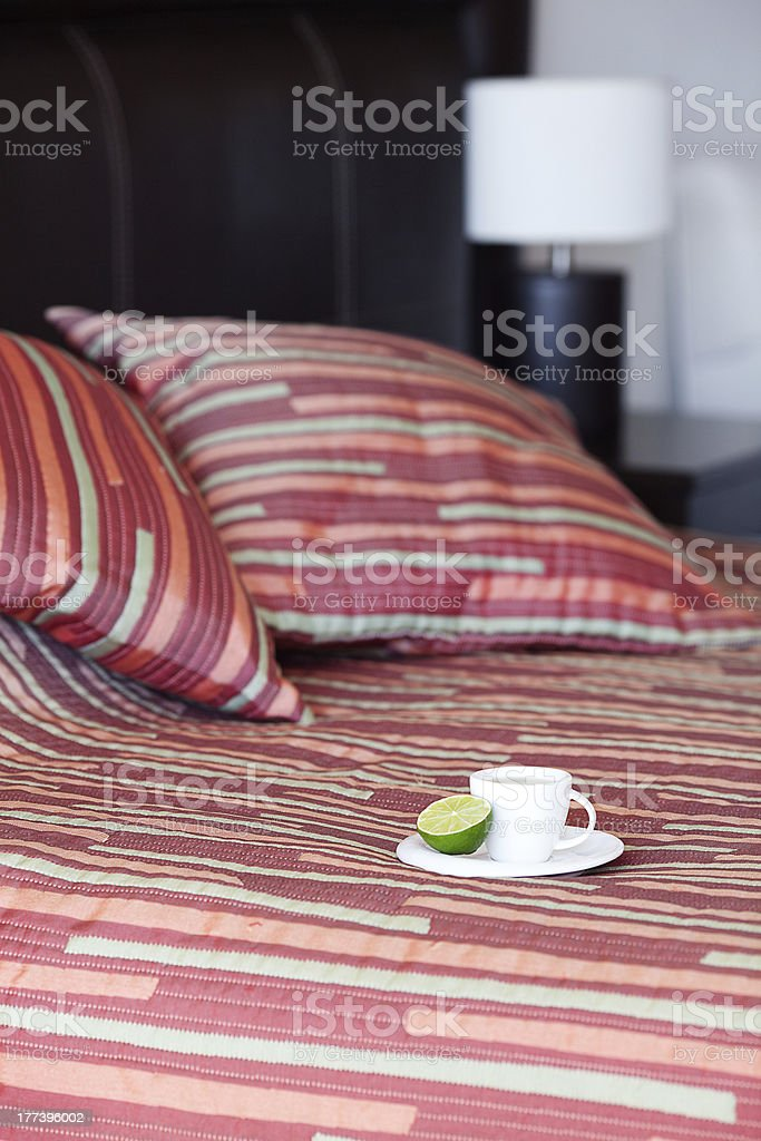 bed with a pillow,  cup of tea royalty-free stock photo