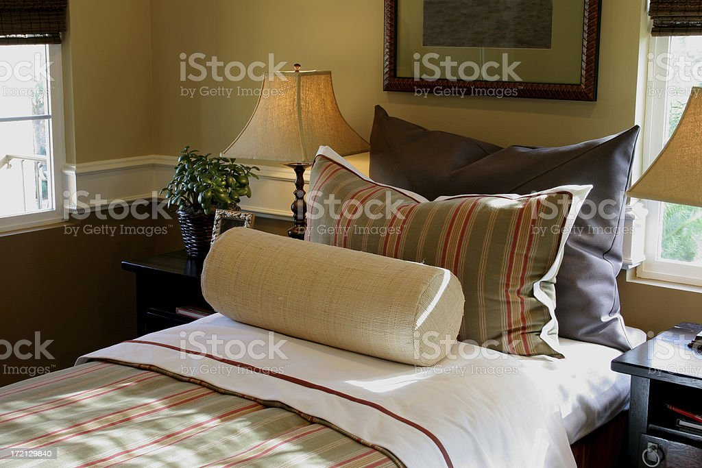 Bed with different pillows royalty-free stock photo