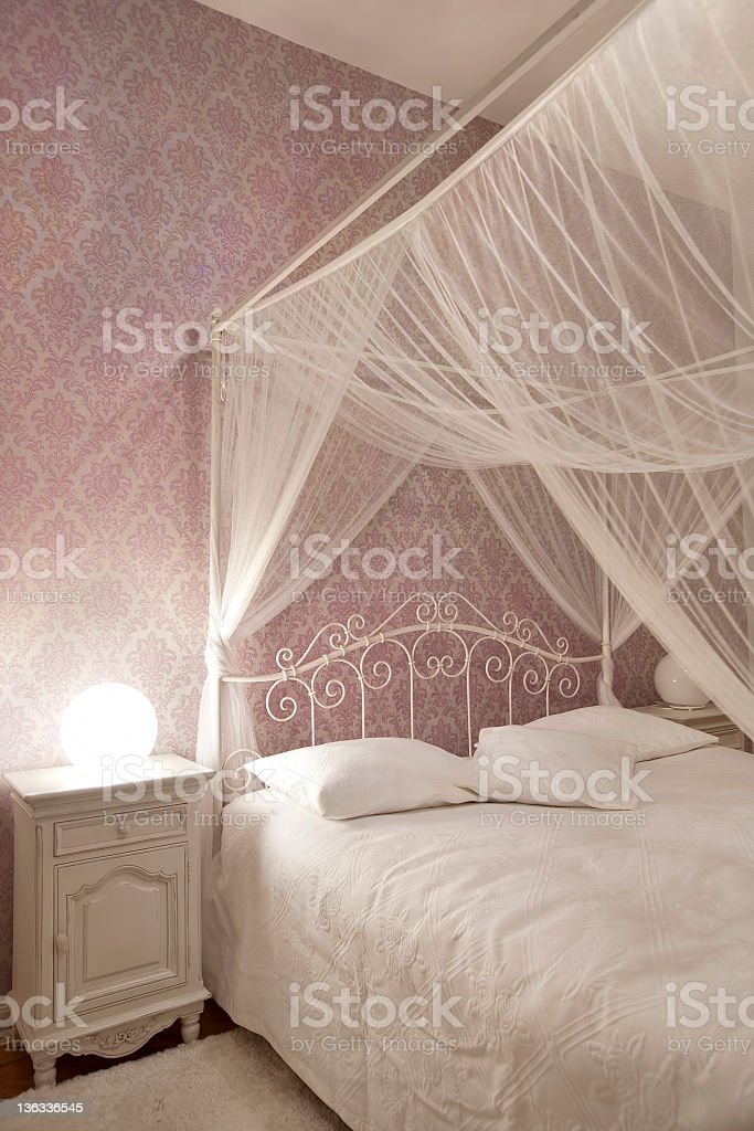 bed with mosquito net royalty-free stock photo