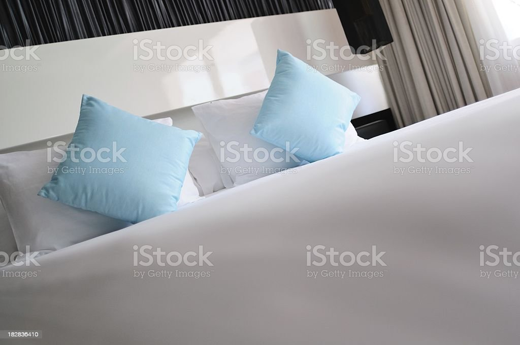 Bed with pillows and clean sheet royalty-free stock photo
