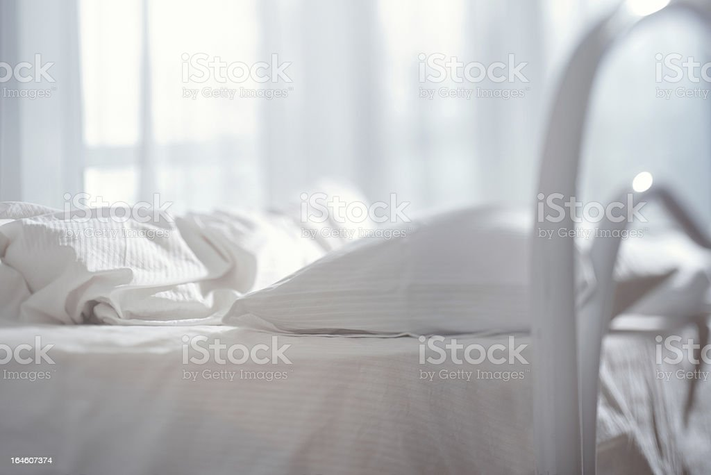 Bed with white bedding and frame royalty-free stock photo