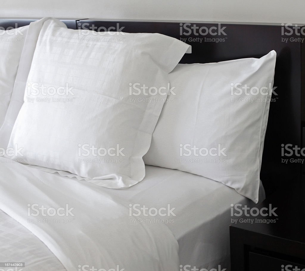 Bed WIth White Pillows stock photo