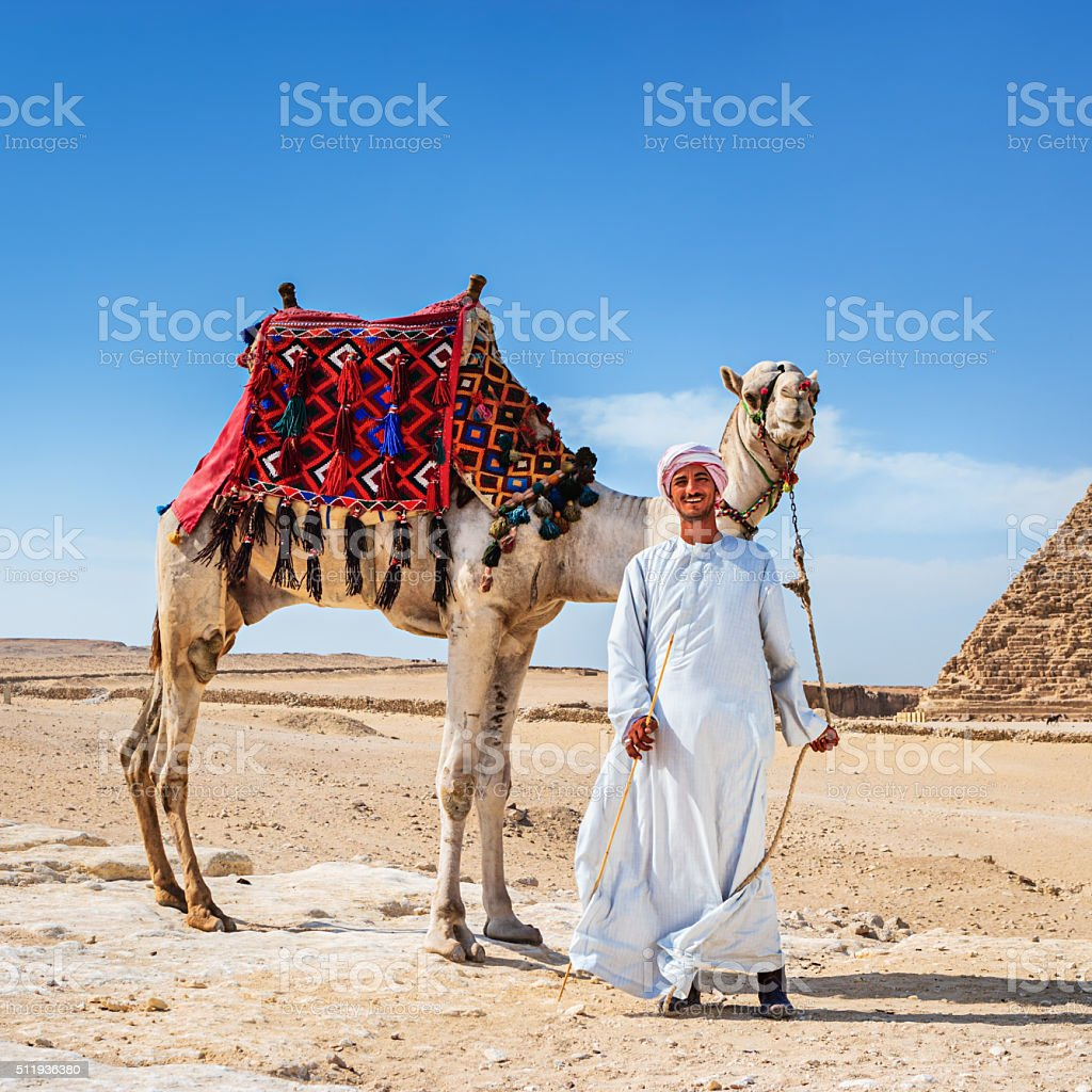Bedouin and the pyramid stock photo