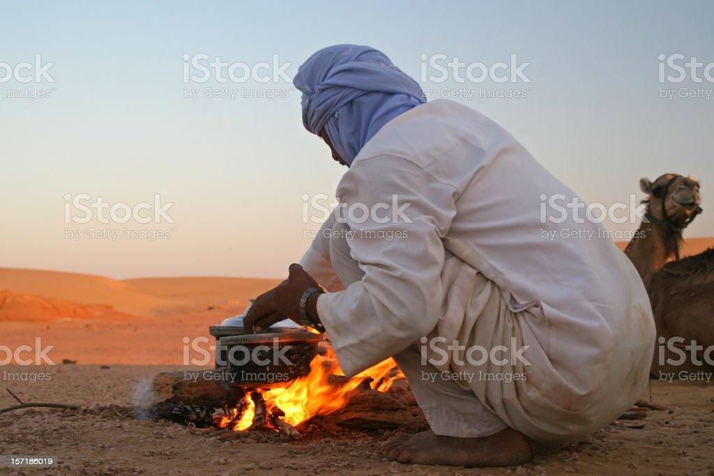 Bedouin making dinner royalty-free stock photo