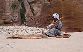 Bedouin man playing traditional instrument