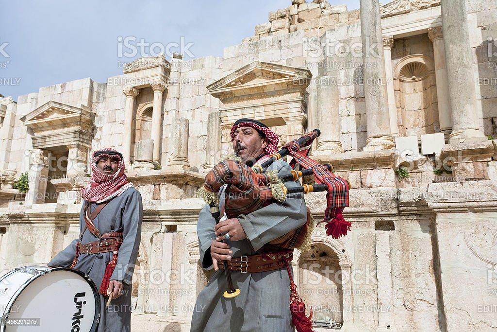 bedouin plays on bagpipes in ancient town Gerasa, Jordan stock photo