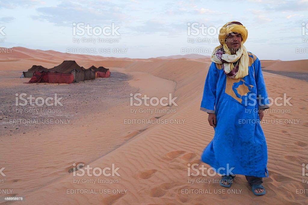 Bedouin standing in front of his tent in Sahara desert,Morocco. stock photo