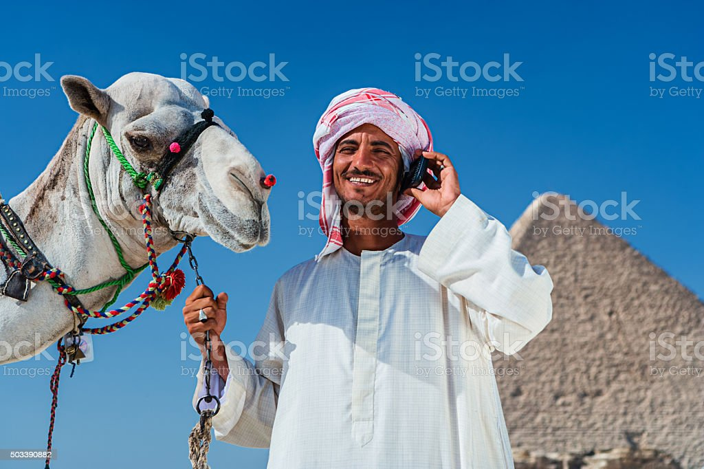 Bedouin using mobile phone stock photo