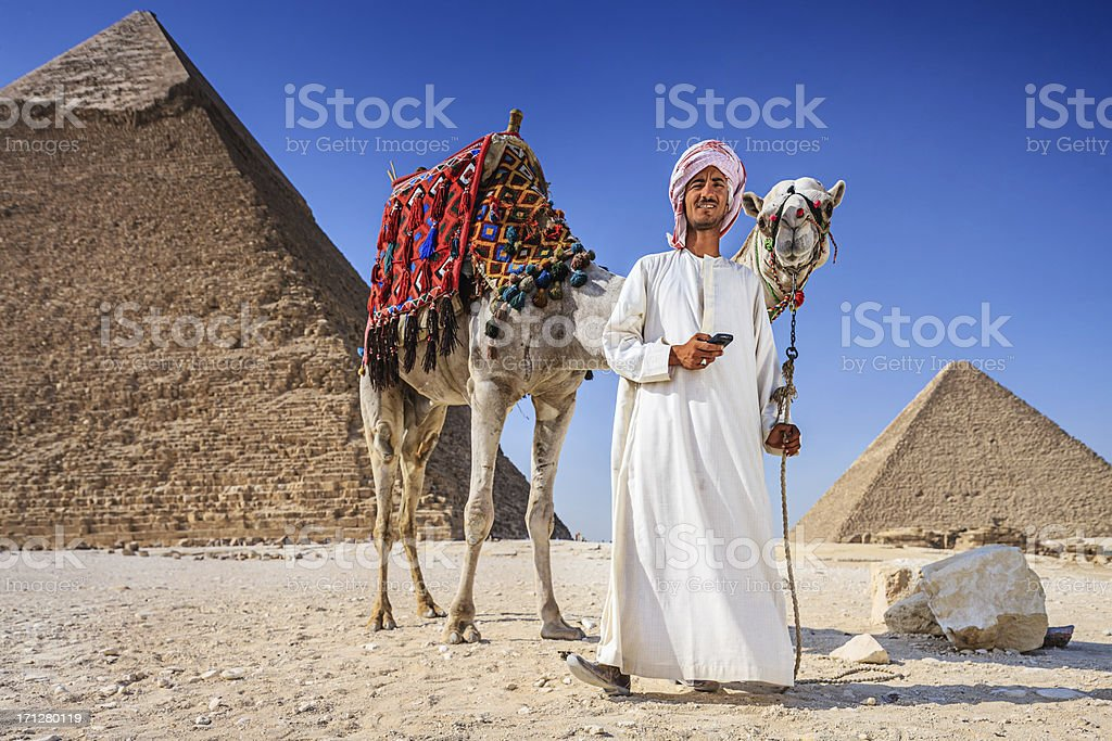 Bedouin using phone royalty-free stock photo