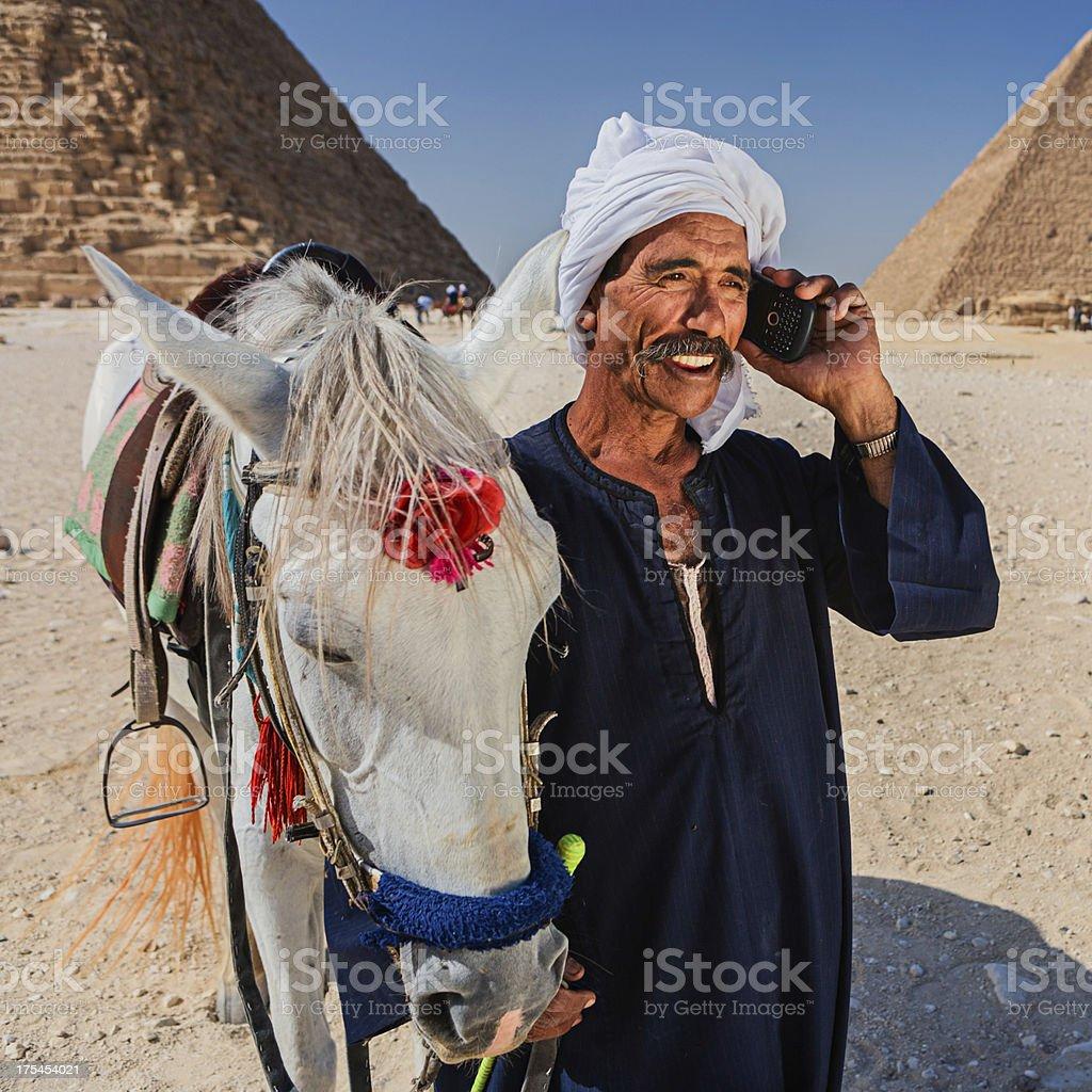 Bedouin using phone royalty-free stock photo