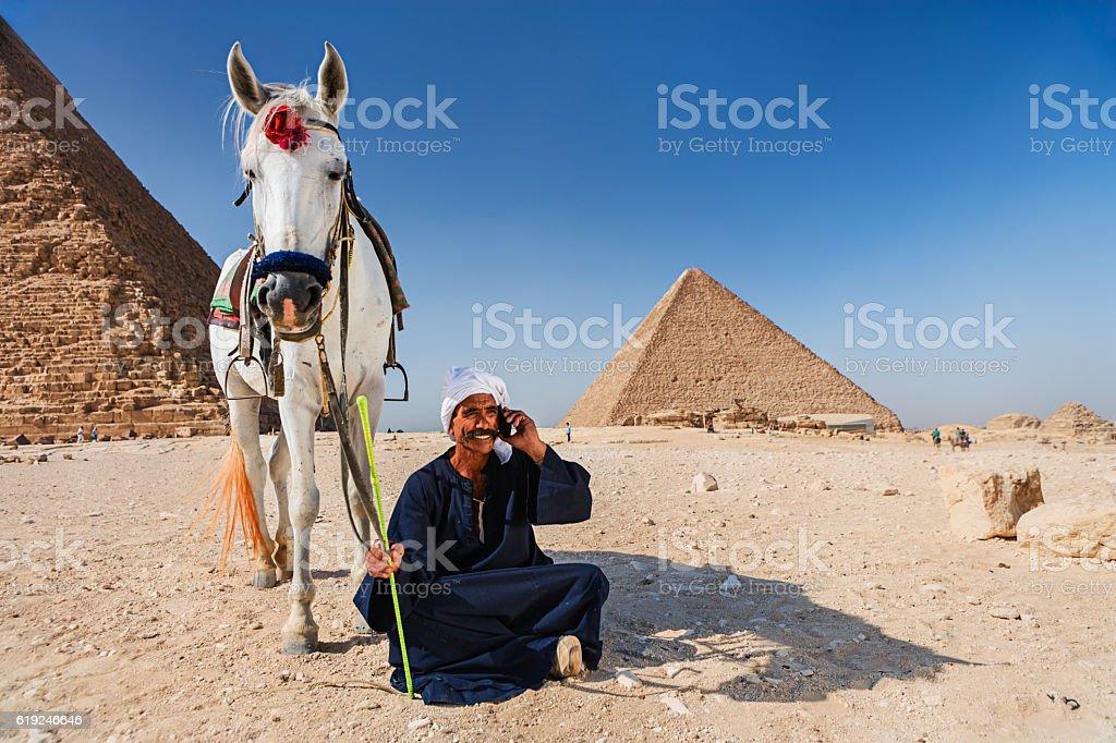 Bedouin using phone stock photo