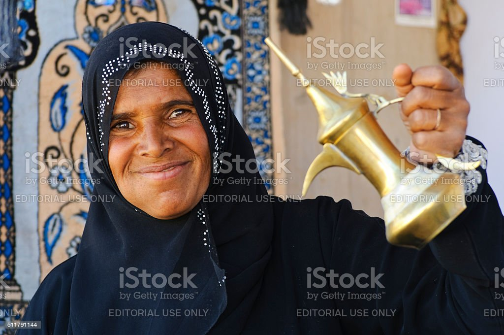 Bedouin woman and coffee pot stock photo
