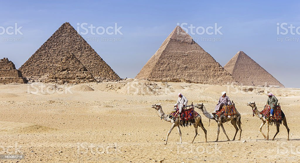 Bedouins and pyramids stock photo