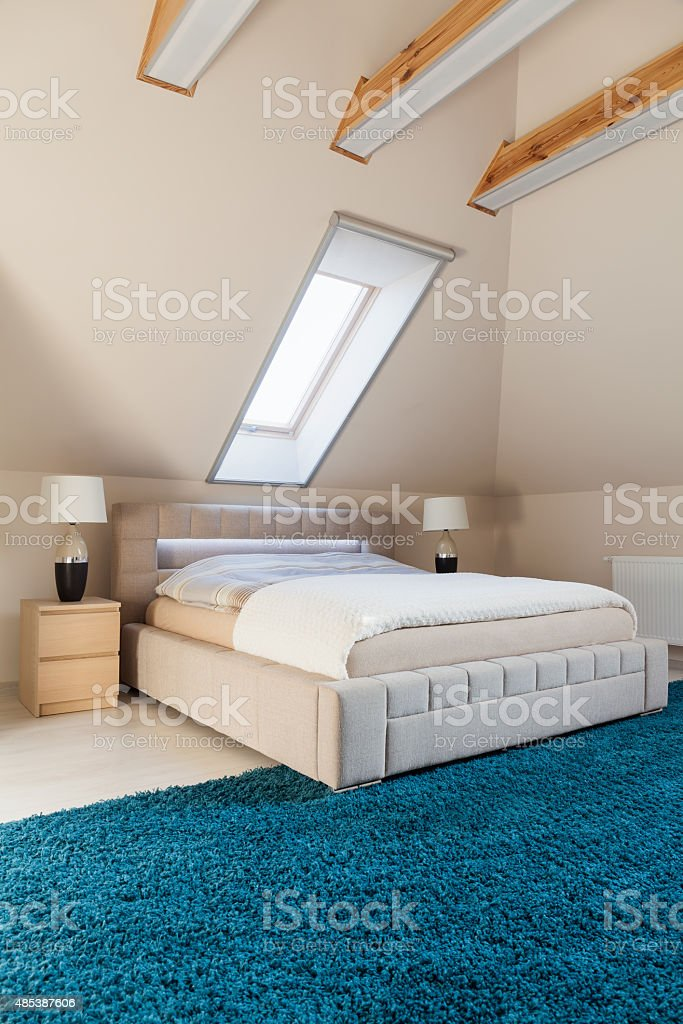 Bedroom arranged in the attic stock photo