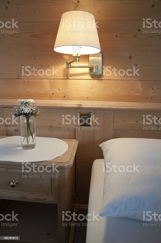 bedroom in a swiss chalet during ski weekend stock photo