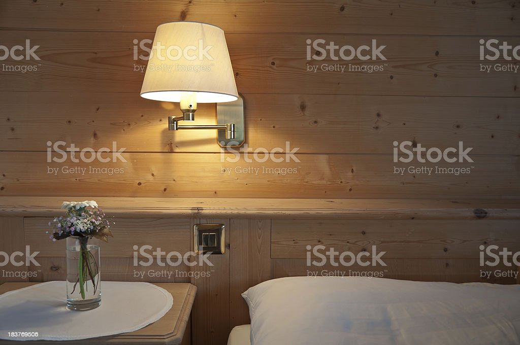 bedroom in a swiss chalet stock photo