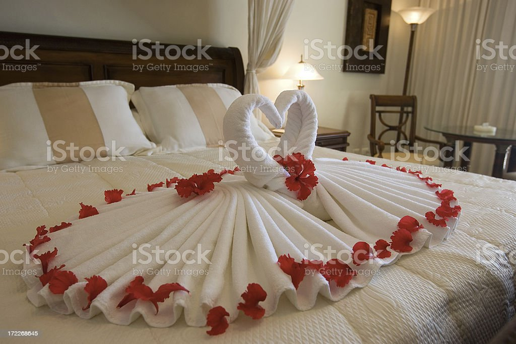 Bedroom in Romantic Hotel Suite with Heart Shaped Decorations royalty-free stock photo