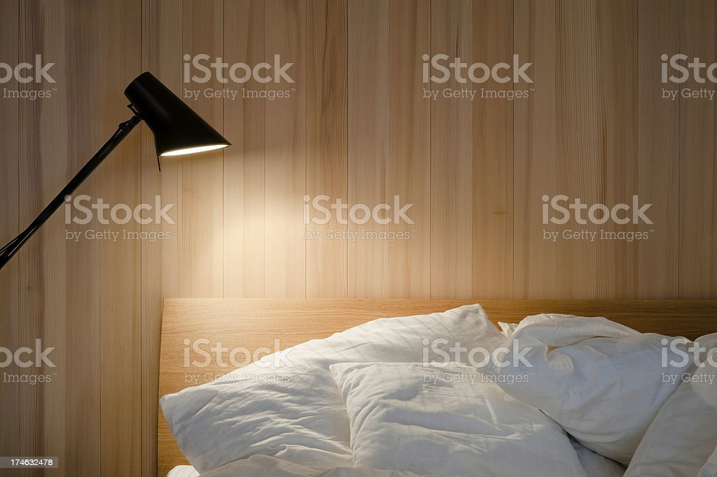 Bedroom in the morning with bedside lamp stock photo