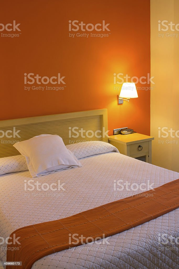 Bedroom in warm yellow and orange colors royalty-free stock photo