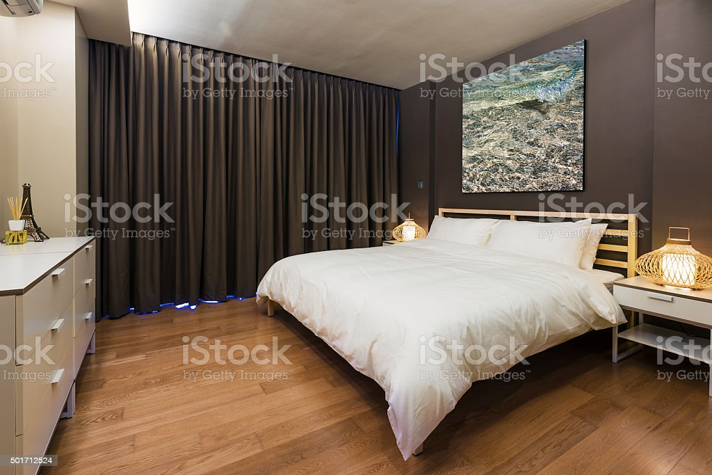 Bedroom interior design. Large bed and Big window stock photo