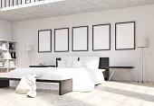 Bedroom interior with empty frames