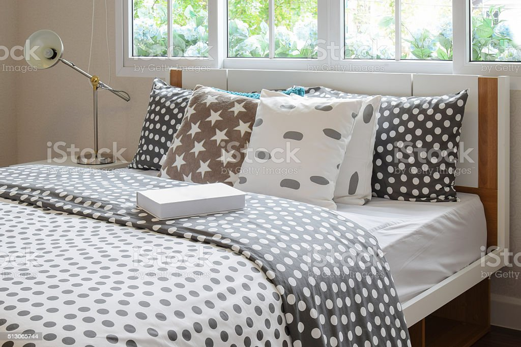 bedroom interior with polka dot pillows on bed stock photo