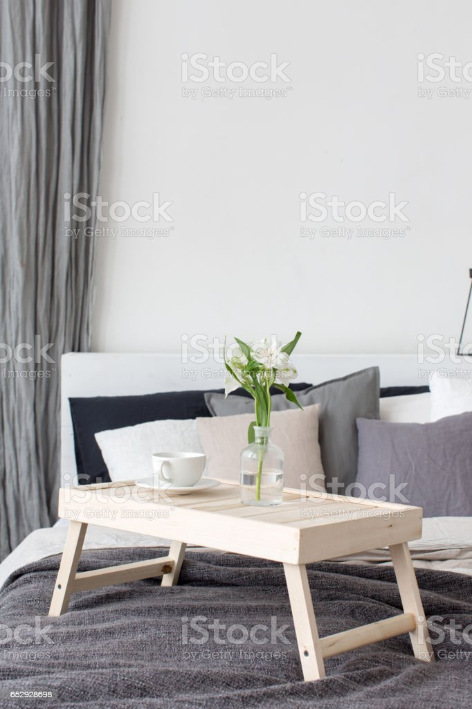 Bedroom interior with small table on bed stock photo