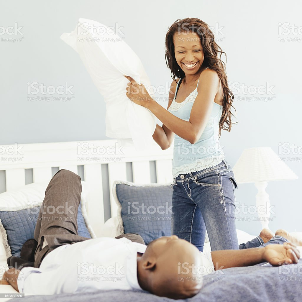 Bedroom Joking,Couple Having a Pillow Fight royalty-free stock photo