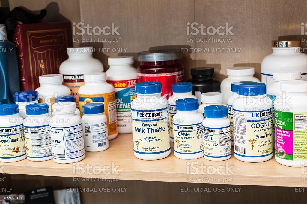 Bedroom Shelf Full of Nutritional Supplement Bottles stock photo