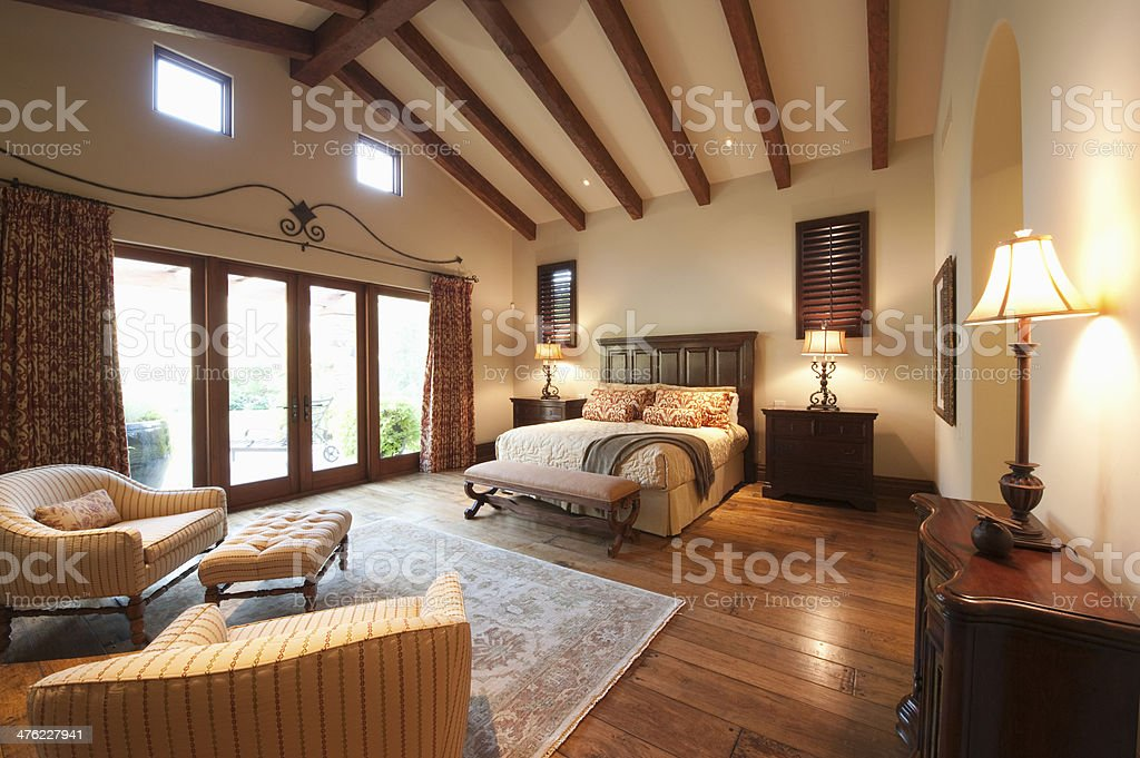 Bedroom With Beamed Wooden Ceiling stock photo