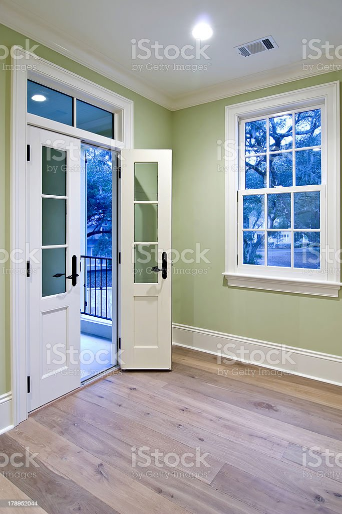 bedroom with double doors stock photo