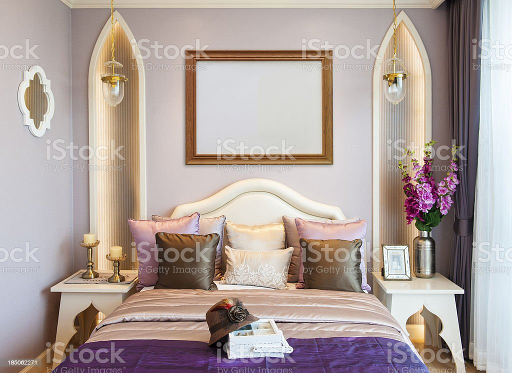 Bedroom with empty frame royalty-free stock photo